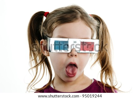 Humorous image of excited child in 3-D glasses with white background. - stock photo