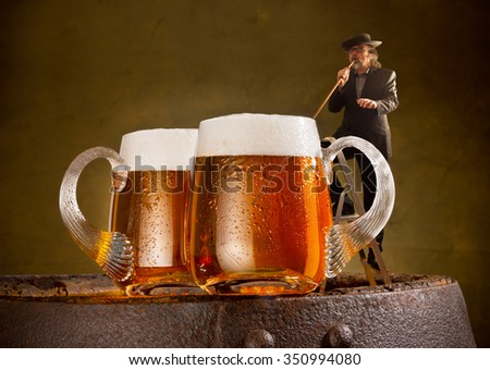 humorous image with drinker and two beers - stock photo