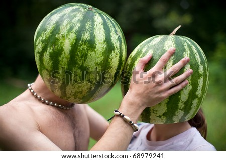 Humorous photo about love of two watermelons - stock photo