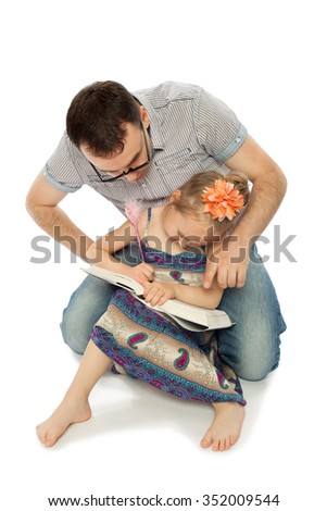 Humorous photo. Dad wore glasses , he looks on as his daughter draws in the book - Isolated on white background - stock photo
