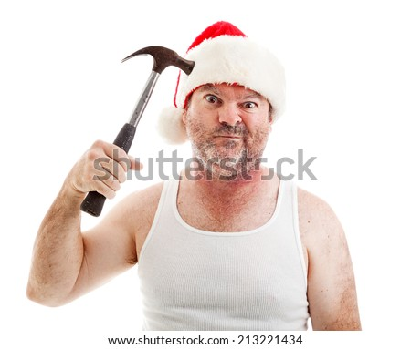 Humorous photo of a man frustrated with Christmas pretending to hit himself on the head with a hammer and making a funny face.