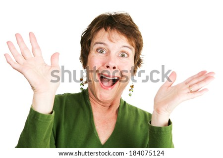 Humorous photo of a mature woman excited and overjoyed.  Isolated on white.