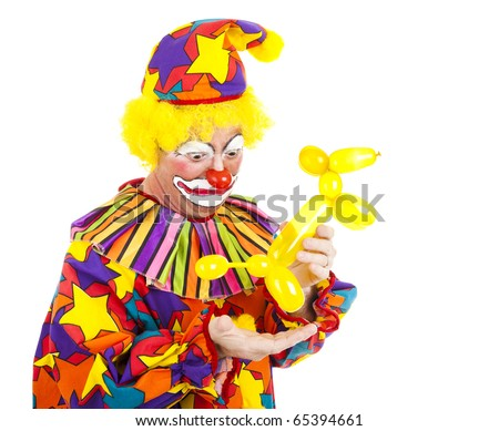 Humorous picture of a clown looking disgusted as a balloon animal poops in his hand.