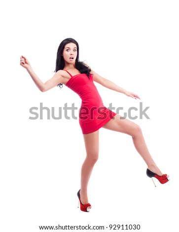 humorous portrait of a sexy young brunette woman running, isolated against white background