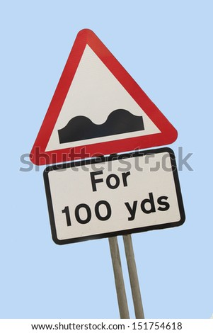 humps in road warning sign  - stock photo