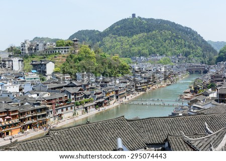 HUNAN, CHINA - April 14 : Old houses in Fenghuang county on Apr 14, 2015 in Hunan, China. The ancient town of Fenghuang was added to the UNESCO World Heritage Tentative List in the Cultural category.