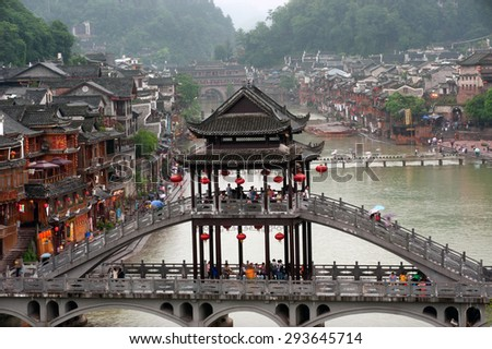 HUNAN, CHINA - JUNE 8 : Old houses in Fenghuang county on June 8, 2015 in Hunan, China. The ancient town of Fenghuang was added to the UNESCO World Heritage Tentative List in the Cultural category. - stock photo
