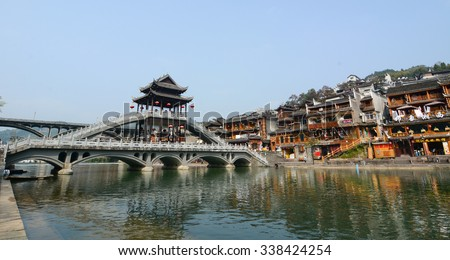 HUNAN, CHINA - OCT 22, 2015. Old houses and bridge located at Fenghuang county in Hunan, China. The ancient town of Fenghuang was added to the UNESCO World Heritage Tentative List.