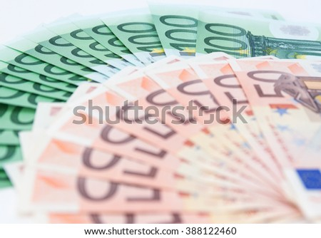 Hundred and fifty euro banknotes spread out on the table. - stock photo