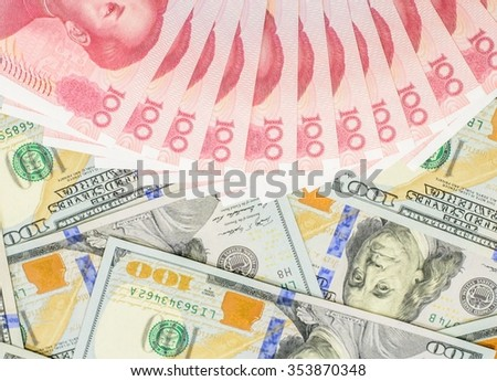 Hundred banknotes of Chinese currency yuan and American dollars,Focus on Chinese banknote - stock photo