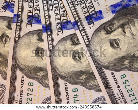 hundred dollar bank notes with image of president Benjamin Franklin - stock photo