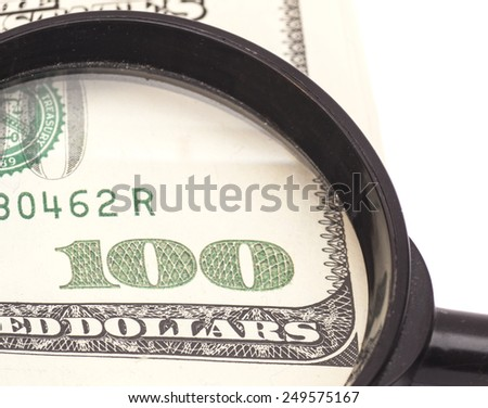 Hundred dollar banknote under magnifying glass