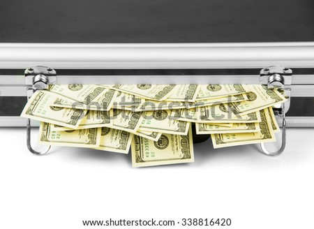 Hundred dollar bill sticking out of a closed suitcase