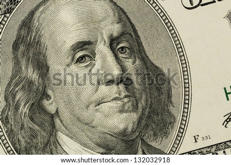 hundred dollar bill with a portrait of benjamin franklin - stock photo