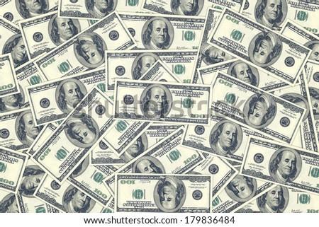 Hundred dollar bills as background. Money pile, financial theme. - stock photo