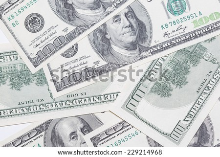 Hundred dollar bills as background. Money pile, financial theme. - stock photo