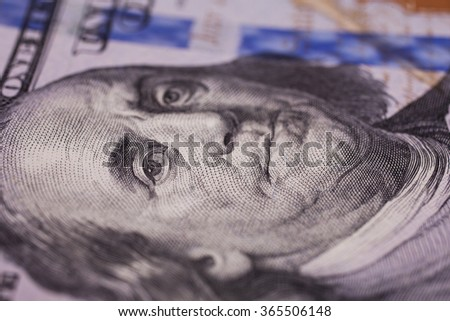 hundred dollar bills front side. new hundred-dollar bill, close up macro, Portrait of Benjamin Franklin on the hundred-dollar bills, the evolution of the bill in one hundred dollars - stock photo