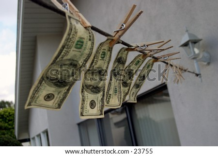 Hundred dollar bills hanging on a rope.  Money laundering concept   - stock photo
