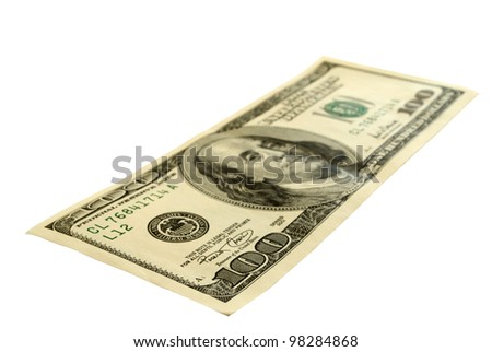 Hundred-dollar bills, isolated on a white background, the outlines of the saved. - stock photo