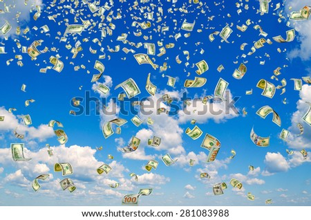 Hundred-dollar bills on a blue sky background. - stock photo
