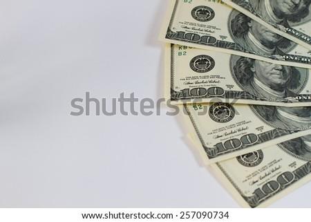 Hundred-dollar bills on a white background - stock photo