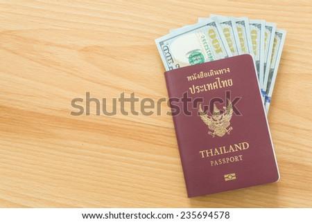 hundred dollar bills thai passport - stock photo