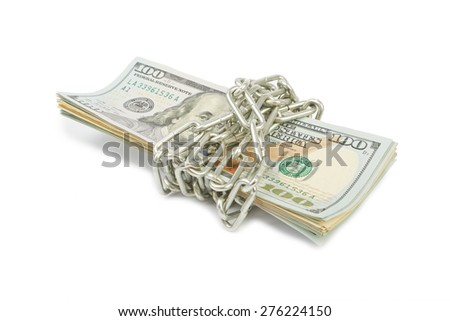 Hundred-dollar bills tied with a silver chain - stock photo