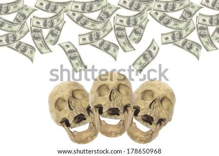 Hundred-dollar bills with three skulls. - stock photo