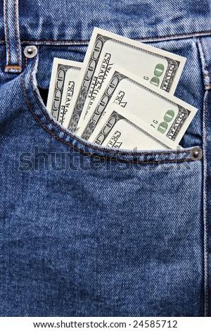 Hundred dollar notes in jeans pocket - stock photo