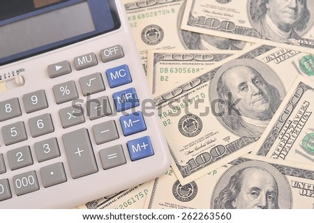 hundred dollars and calculator - stock photo