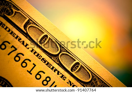 Hundred dollars banknote with colorful blurred background - stock photo