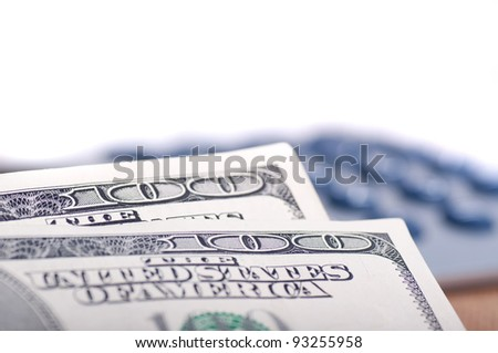 Hundred dollars bills and blurred calculator keys in the background - stock photo