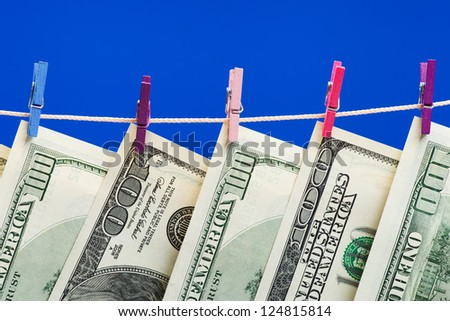 Hundred dollars hanging on a clothesline. Money laundering concept - stock photo