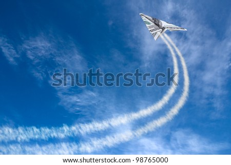 Hundred dollars plane on cloudy sky and trace . - stock photo