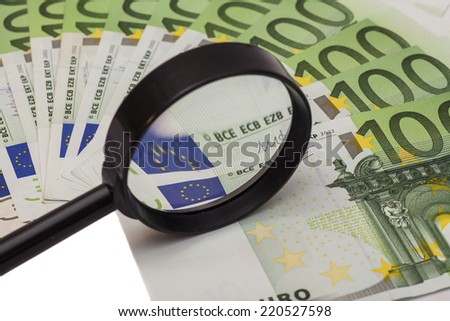 Hundred euro banknote under magnifying glass  - stock photo