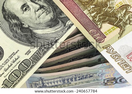 Hundred rubles and one hundred dollars on a background of Russian banknotes - stock photo