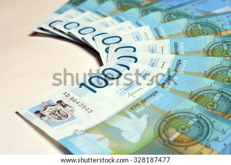 Hundred serbian dinars are on white background.