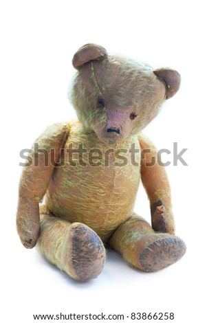 hundred years old and sad teddy bear - stock photo
