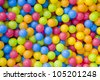 Hundreds of colored plastic balls. - stock photo