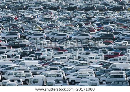 hundreds of new cars waiting for their owners - stock photo