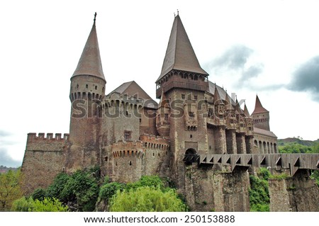 HUNEDOARA - MAY 16: The Huniazilor or Corvinestilor castle, is one of top ten most beautiful castles in the World and is visited every year by a crowd of people. On May 16, 2004, in Hunedoara, Romania - stock photo