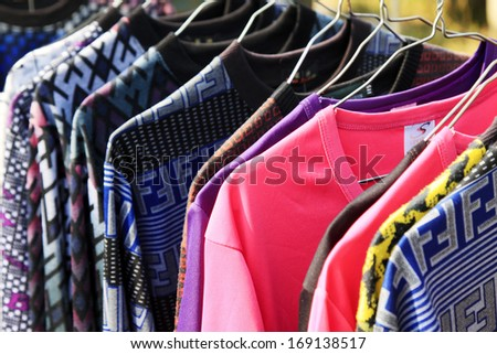 Hung clothes in a store, closeup of photo