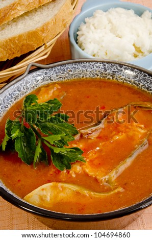 Hungarian fish soup with home made bread and rice - stock photo