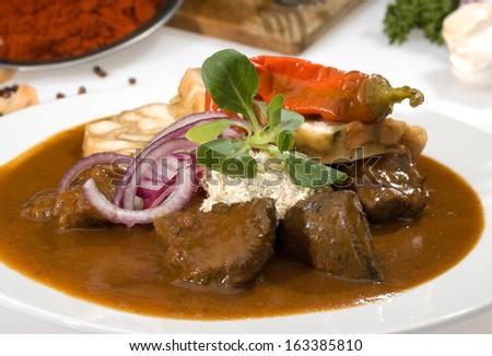 Hungarian goulash w dumplings and horseradish - stock photo