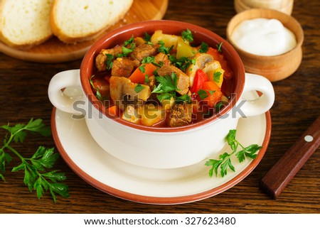 Hungarian goulash with mushrooms and vegetables. - stock photo