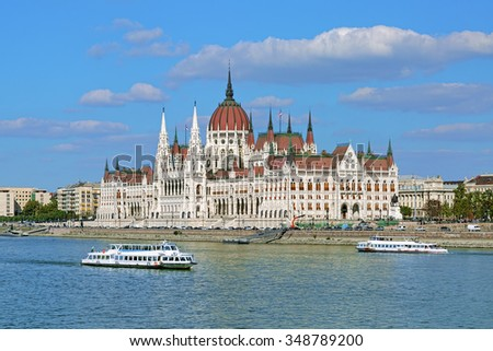 Hungarian Parliament Building and two sightseeing ships on the Danube in Budapest, Hungary - stock photo