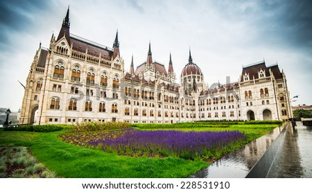Hungarian Parliament building with reflection in Budapest, Hungary - stock photo