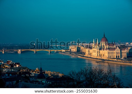 Hungarian parliament with Margaret bridge view in the evening in Budapest - stock photo