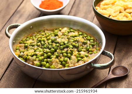 Hungarian pea stew made of onion and peas and seasoned with paprika and salt, served usually with Hungarian galuska or nokedli (homemade noodles) (Selective Focus, Focus into the middle of the stew) - stock photo