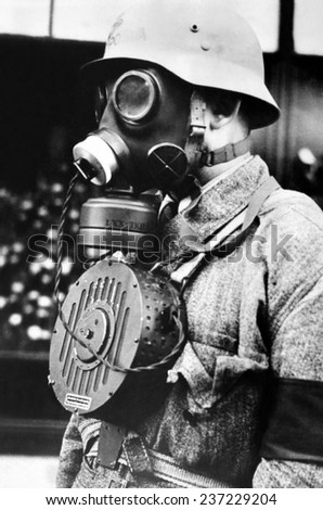 Hungarian soldier wearing a new type of gas mask with a microphone to enable conversation during a gas attack Nov 10, 1939. - stock photo
